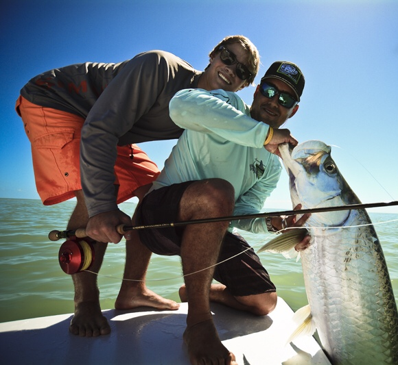 Miami fly fishing guide captain and client with Tarpon