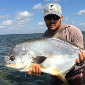 upper keys fishing charter client with permit