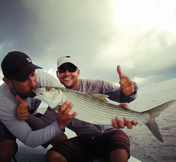fishing charters in miami captain and client with bonefish
