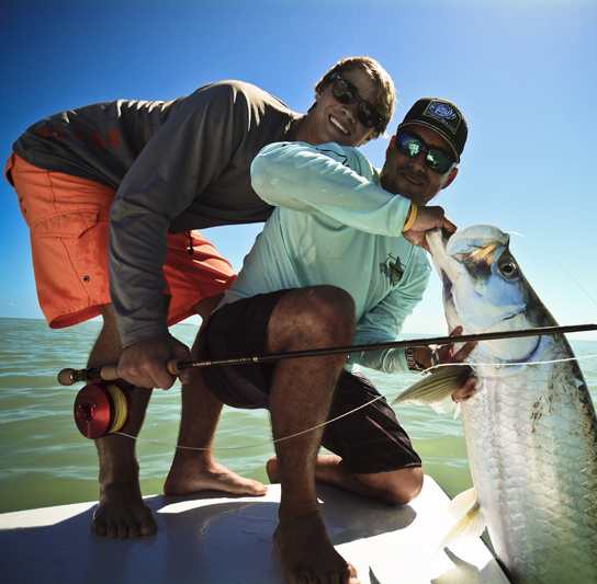 miami fly fishing guide with client and large tarpon